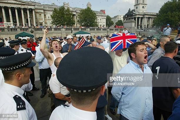 Nationalists shouts their message at the 'Rally for Islam' at Trafalgar Square in central London 25 August 2002 Some 400 hundred AlMuhajiroun...