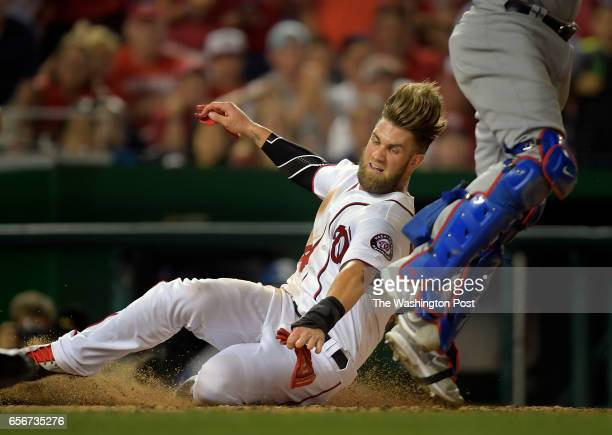 Nationals' Bryce Harper is safe at home after running all the way from 1st base on a Wilson Ramos 6th inning double as the Washington Nationals play...