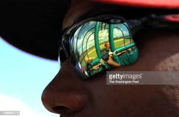 Nationals' scout Pablo Arias shoots a radar gun to get the speed of a pitcher's thrown ball during a weekly tryout at the Washington Nationals half...