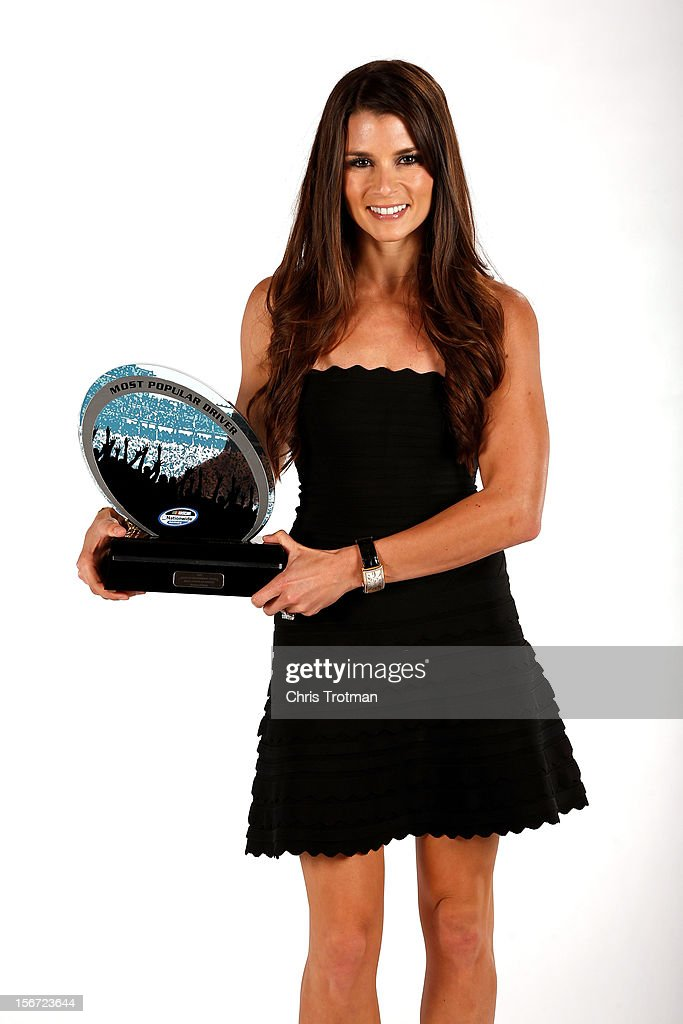 Nationwide driver <a gi-track='captionPersonalityLinkClicked' href=/galleries/search?phrase=Danica+Patrick&family=editorial&specificpeople=183352 ng-click='$event.stopPropagation()'>Danica Patrick</a> poses with the Most Popular Driver Award during the NASCAR Nationwide Series And Camping World Truck Awards Banquet at Loews Miami Beach on November 19, 2012 in Miami Beach, Florida.
