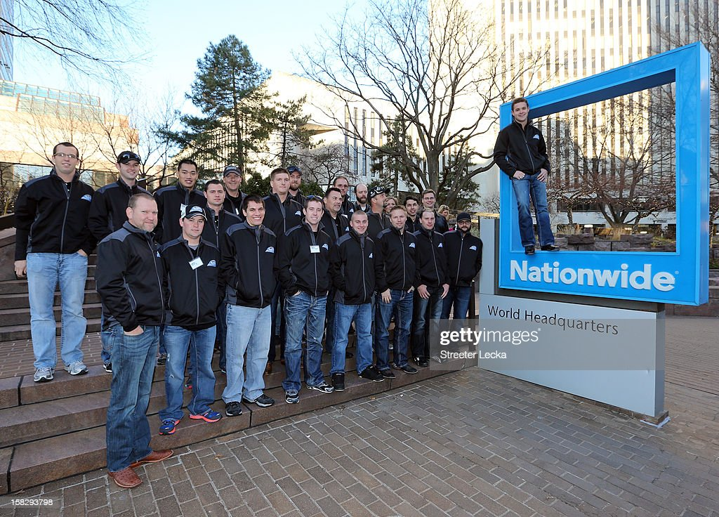 Nationwide Series Champion Ricky Stenhouse Jr. and his team pose for a picture outside the Nationwide World Headquarters during the NASCAR Nationwide Series Champion's Day on December 12, 2012 in Columbus, Ohio