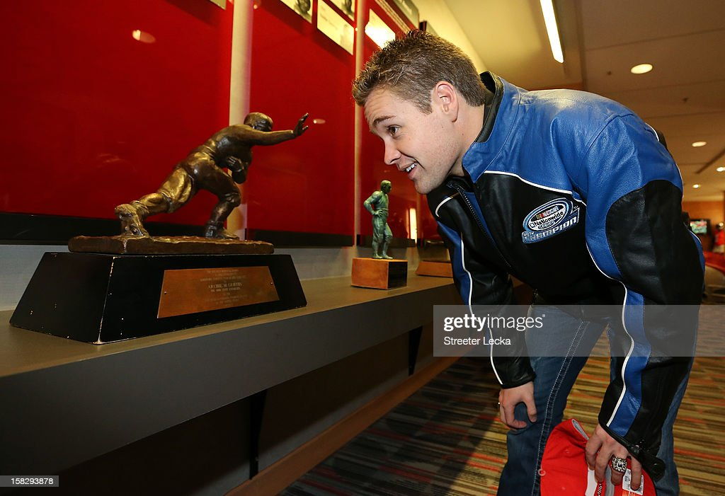 Nationwide Series Champion Ricky Stenhouse Jr. looks at the Heisman Trophy at Ohio State University during the NASCAR Nationwide Series Champion's Day on December 12, 2012 in Columbus, Ohio