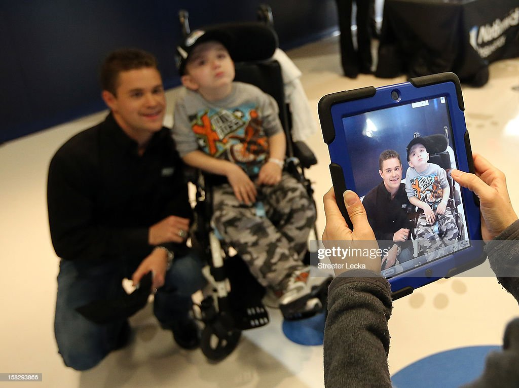Nationwide Series Champion Ricky Stenhouse Jr. poses for pictures with patients at the Nationwide Children's Hospital during the NASCAR Nationwide Series Champion's Day on December 12, 2012 in Columbus, Ohio