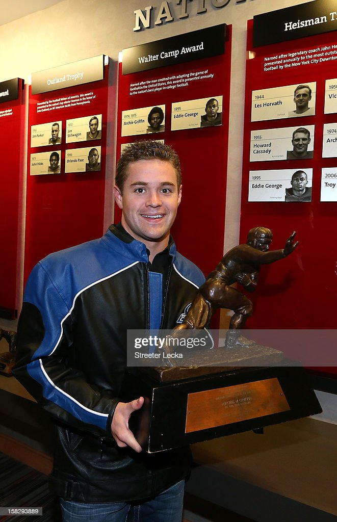 Nationwide Series Champion Ricky Stenhouse Jr. poses the Heisman Trophy at Ohio State University during the NASCAR Nationwide Series Champion's Day on December 12, 2012 in Columbus, Ohio