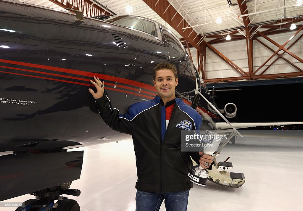 Nationwide Series Champion Ricky Stenhouse Jr. poses with his trophy in a airline hangar during the NASCAR Nationwide Series Champion's Day on December 12, 2012 in Columbus, Ohio