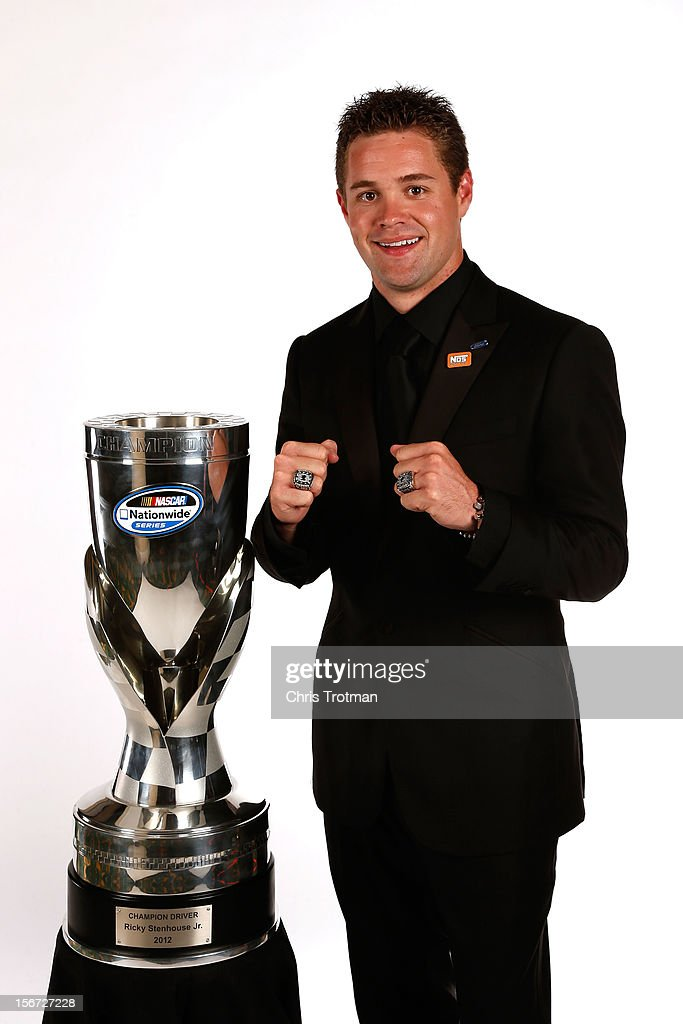 Nationwide Series Champion <a gi-track='captionPersonalityLinkClicked' href=/galleries/search?phrase=Ricky+Stenhouse+Jr.&family=editorial&specificpeople=5380612 ng-click='$event.stopPropagation()'>Ricky Stenhouse Jr.</a> poses with his two rings and trophy during the NASCAR Nationwide Series And Camping World Truck Awards Banquet at Loews Miami Beach on November 19, 2012 in Miami Beach, Florida.