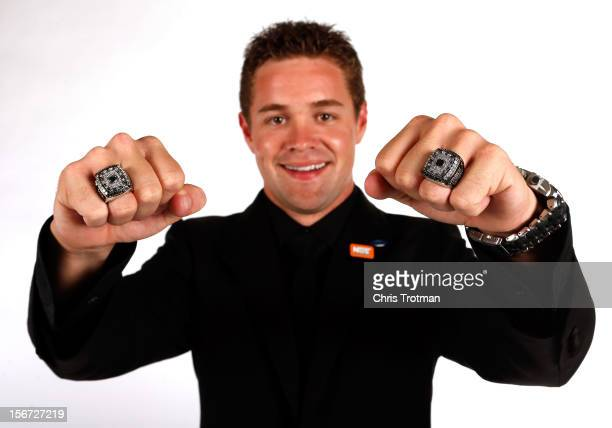 Nationwide Series Champion Ricky Stenhouse Jr poses with his two rings during the NASCAR Nationwide Series And Camping World Truck Awards Banquet at...