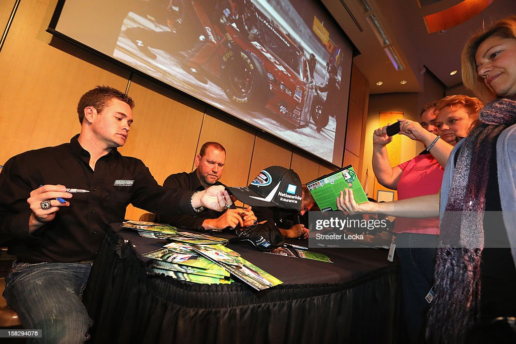 Nationwide Series Champion Ricky Stenhouse Jr. signs autographs at the Nationwide Headquarters during the NASCAR Nationwide Series Champion's Day on December 12, 2012 in Columbus, Ohio