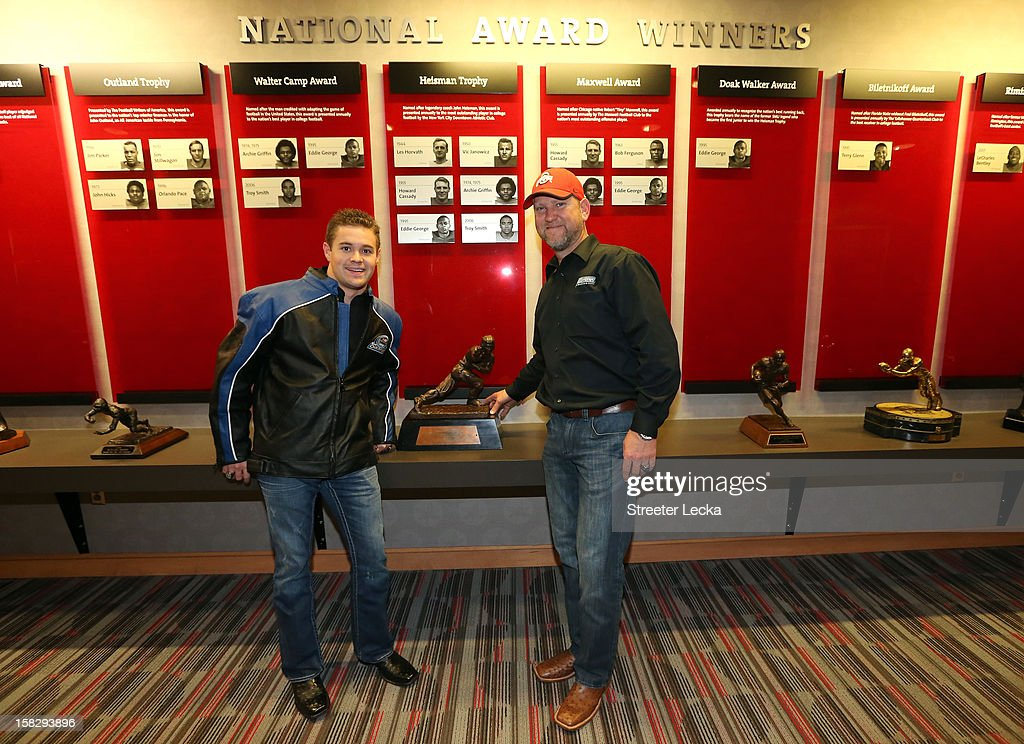 Nationwide Series Champion Ricky Stenhouse Jr. stands with his crew chief Mike Kelley in front of the Heisman Trophy during the NASCAR Nationwide Series Champion's Day on December 12, 2012 in Columbus, Ohio