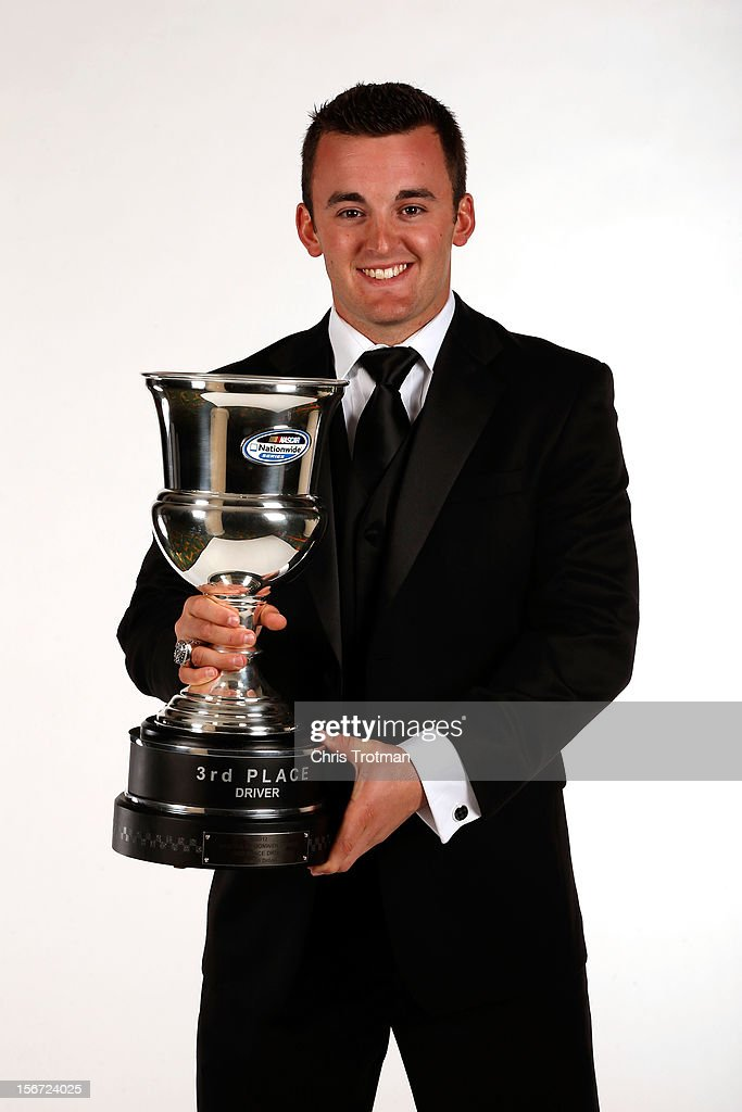 Nationwide Series driver <a gi-track='captionPersonalityLinkClicked' href=/galleries/search?phrase=Austin+Dillon&family=editorial&specificpeople=5075945 ng-click='$event.stopPropagation()'>Austin Dillon</a> poses with the third place trophy during the NASCAR Nationwide Series And Camping World Truck Awards Banquet at Loews Miami Beach on November 19, 2012 in Miami Beach, Florida.