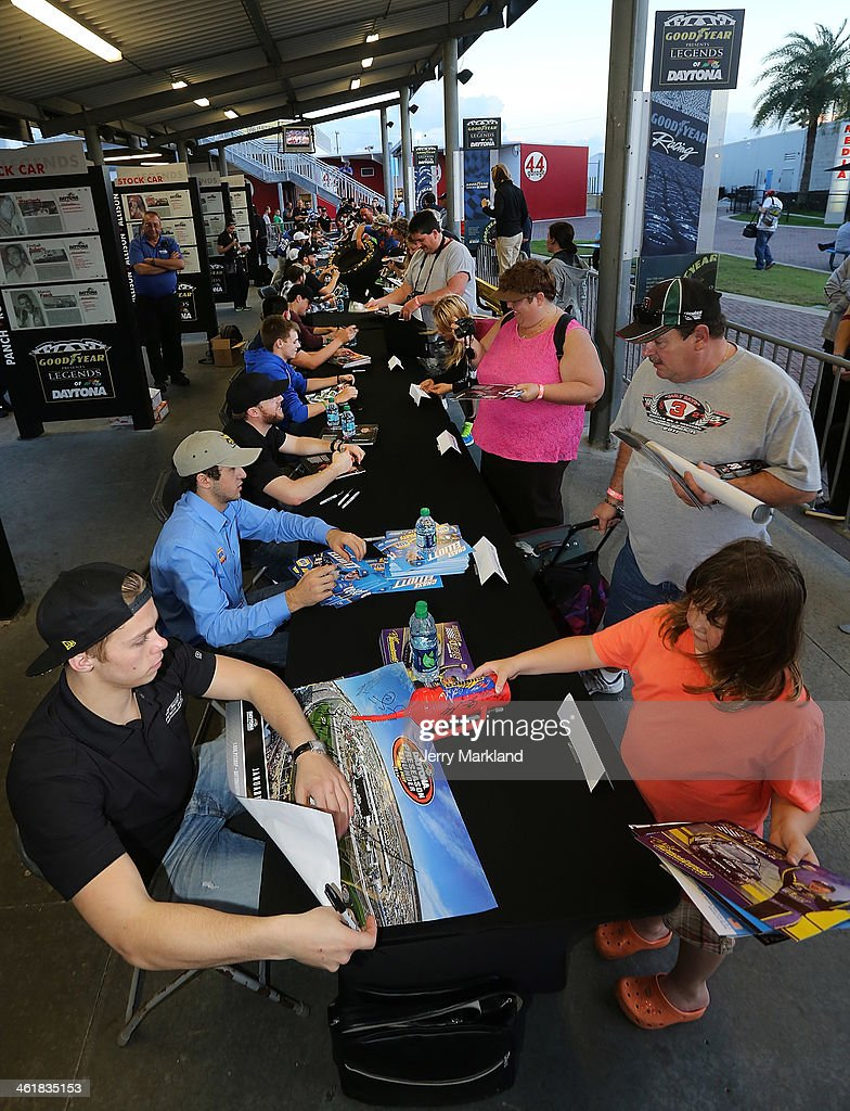 Nationwide Series drivers sign autographs for fans during NASCAR Preseason Thunder at Daytona International Speedway on January 11, 2014 in Daytona Beach, Florida.