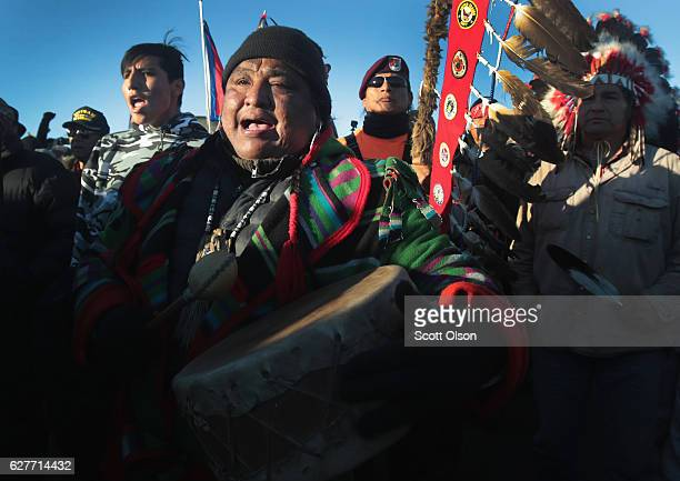Native American activists celebrate after learning an easement had been denied for the Dakota Access Pipeline at Oceti Sakowin Camp on the edge of...
