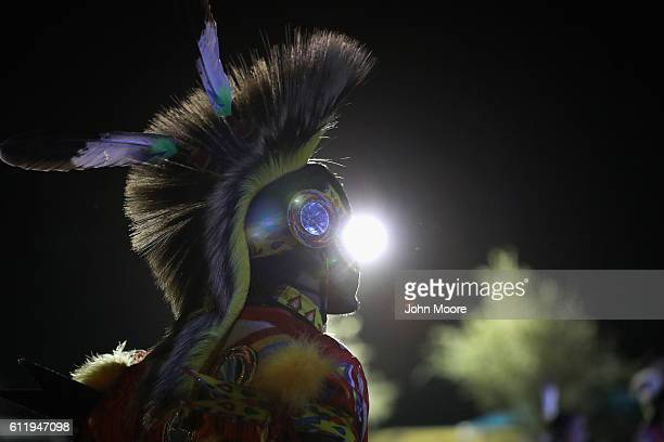 Native American dancer watches as fellow traditional dancers perform at the 'Rocking the Rez' Pow Wow on October 1 2016 in Ysleta del Sur Pueblo...