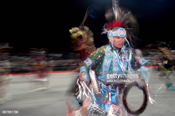 TOPSHOT Native American dancers compete in the Men's Chicken Dance during the Denver March Powwow on March 24 2017 in Denver Colorado Held over four...