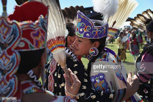 Native American dancers embrace after performing at the 'Rocking the Rez' Pow Wow on October 1 2016 in Ysleta del Sur Pueblo Texas The pow wow held...
