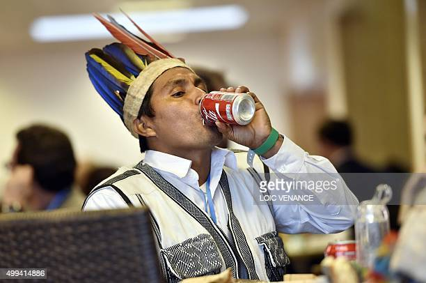 TOPSHOT A native American drinks from a can during the United Nations conference on climate change COP21 on December 1 2015 at Le Bourget on the...