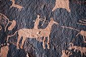 Hunter petroglyph on Newspaper Rock in Canyonlands National Park, Southwest USA