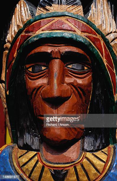 Native American Indian bust wood carving for sale at souvenir shop.