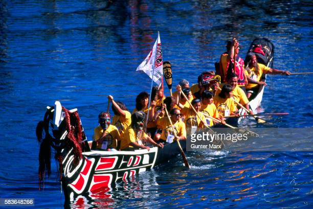 Native American Indians in Traditional Sea-going Dugout War Canoe