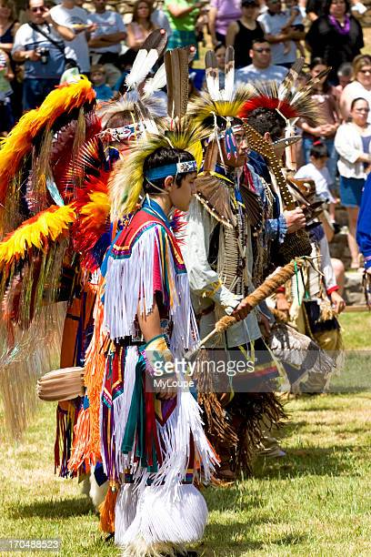 Native American Indians performing a dance in traditional costumes