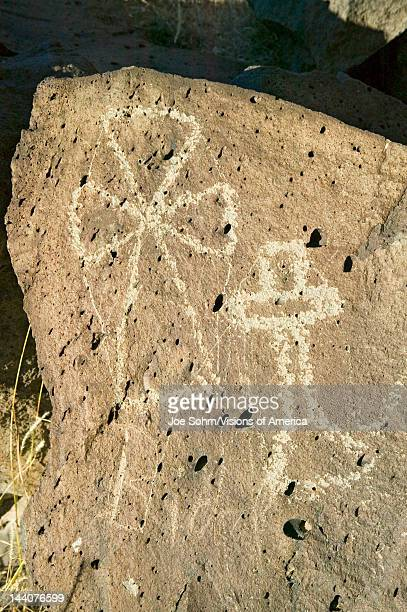 Native American petroglyphs featuring an image of crosses at Petroglyph National Monument outside Albuquerque New Mexico