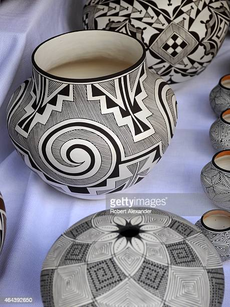 Native American pottery by Robert Patricio from the Acoma Pueblo in New Mexico is for sale in the artist's booth at the Santa Fe Indian Market in...