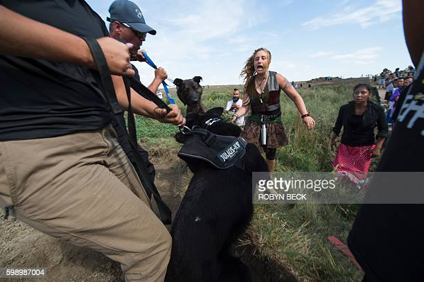 Native American protestors and their supporters are confronted by security during a demonstration against work being done for the Dakota Access...