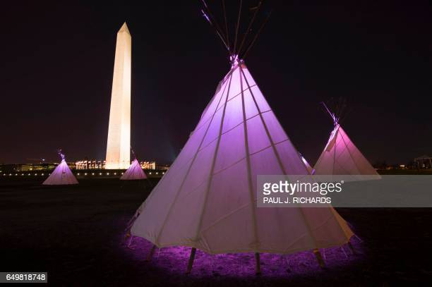 Native American teepees are seen on the National Mall in downtown Washington DC on March 8 with the National Monument to the rear as tribes from...