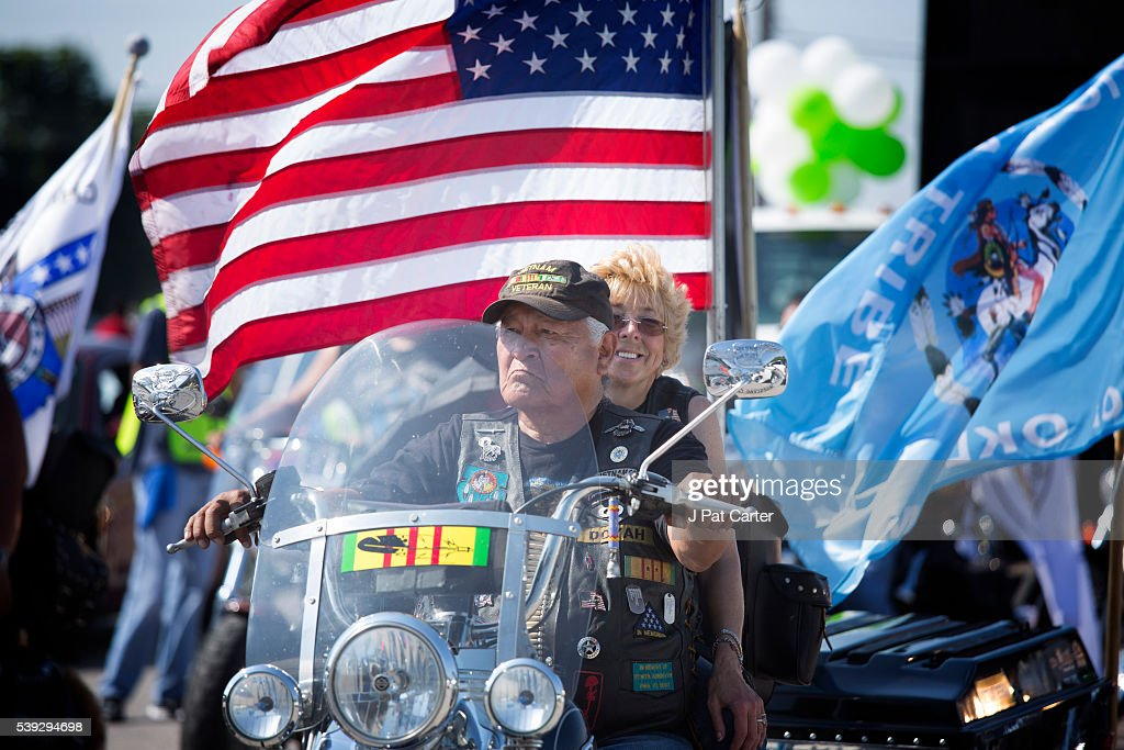 A Native American Vietnam Veteran and his wife ride in the Red Earth Native American Festival parade, Friday, June 10, 2016 in Oklahoma City.