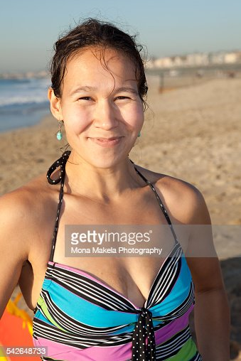Native American woman on the beach