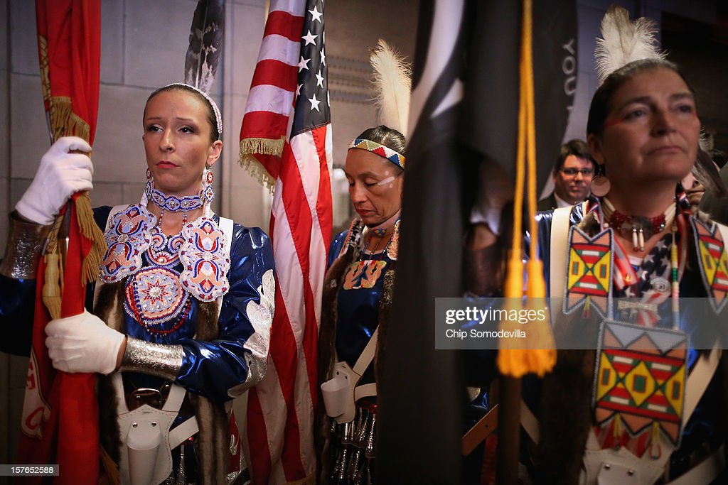 Native American Women Warriors members and U.S. military veterans (L-R) Sarah Baker of Camp Lejeune, North Carolina; Mitchelene Big Man of Lodge Grass, Montana; and Julia Kelly of Billings, Montana prepare to march the colors into the opening ceremony of the White House Tribal Nations Conference at the Department of Interior December 5, 2012 in Washington, DC. President Barack Obama and cabinet secretaries from his administration are scheduled to address the conference, which included breakout sessions on topics like 'Protecting Our Communities: Law Enforcement and Disaster Relief,' 'Building Healthy Communities, Excellence in Education and Native American Youth,' and other subjects.