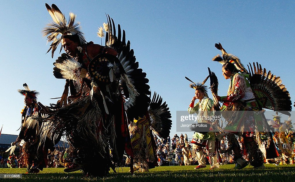 Native Americans dance in the grand entry of the Julyamsh Pow Wow in Post Falls Idaho on July 23 2004 The Julyamsh is touted as the largest pow wow...