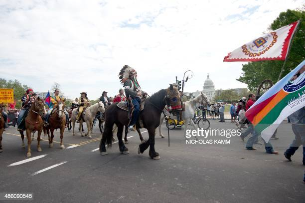 Native Americans farmers and ranchers march in front of the US Capitol in Washington on April 22 2014 as the Cowboy and Indian Alliance protest the...