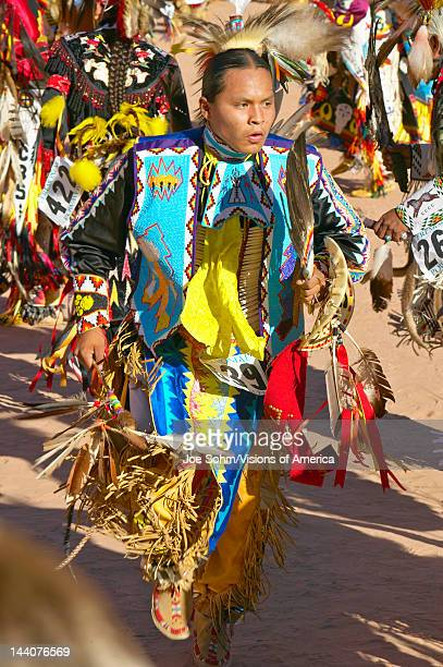 Native Americans in full regalia dancing at Pow wow