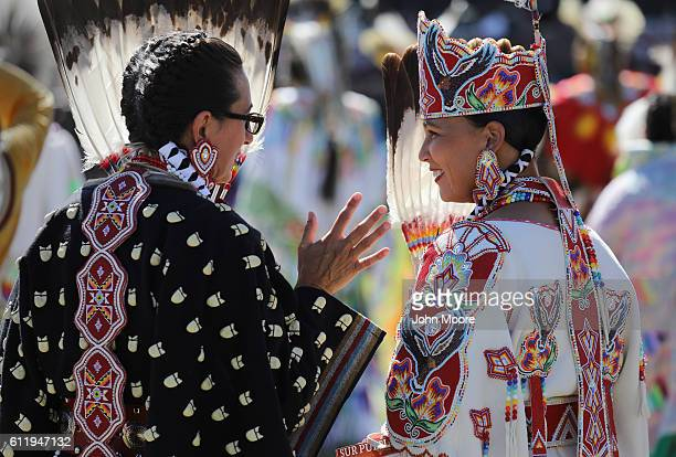 Native Americans in tradional dress talk during the 'Rocking the Rez' Pow Wow on October 1 2016 in Ysleta del Sur Pueblo Texas The pow wow held on...