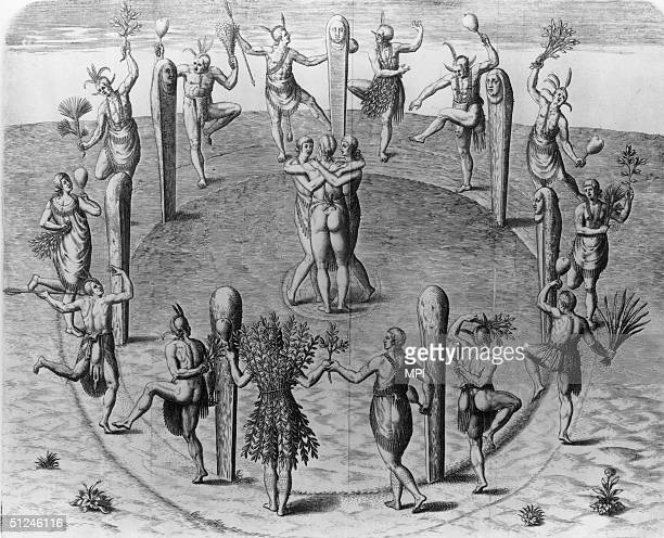1585 Native Americans perform a festive dance wearing elaborate regalia and carrying sprays of leaves