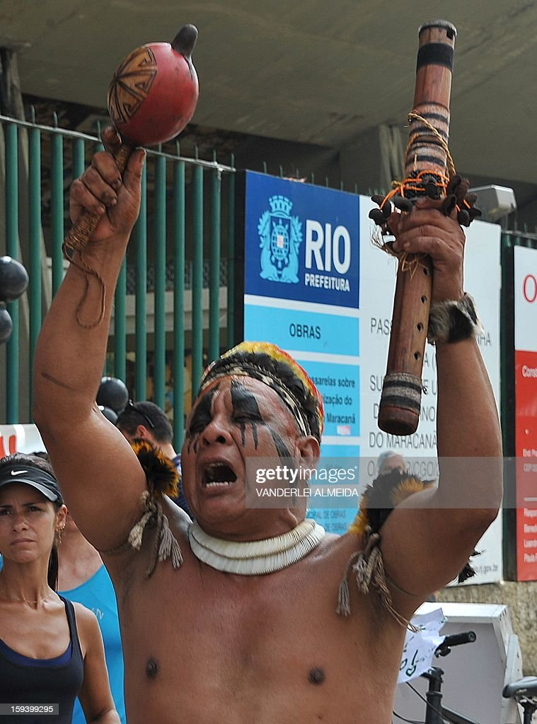 A native Brazilian chants slogans during a protest against the demolition of the Celio de Barros track and field stadium in Rio de Janeiro, Brazil on January 13, 2013. The stadium needs to be demolished to carry out the Maracana stadium construction plans ahead of the 2013 FIFA Confederations Cup, 2014 FIFA World Cup and 2016 Olympic games. AFP PHOTO/VANDERLEI ALMEIDA