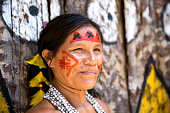 Native Brazilian woman portrait at an indigenous tribe in the Amazon