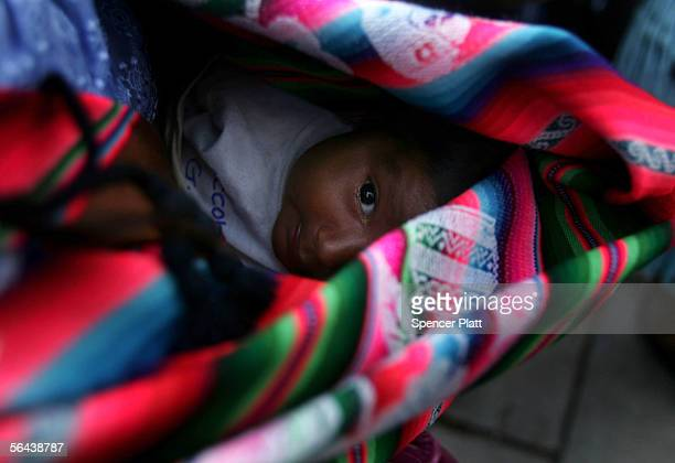 A native campesino or Indian baby looks out from its mother's blanket at a rally for Bolivian Presidential Candidate Evo Morales December 15 2005 in...