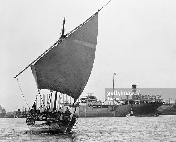 A native dhow with full sail passes a tanker tied up at the Britishowned AngloIranian Oil company docks in Abadan Premier Mohammed Mossadegh asked...