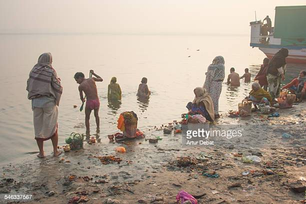 Native Indian people in Varanasi between dirty in the polluted waters of the Ganges river January of 2009 India Asia