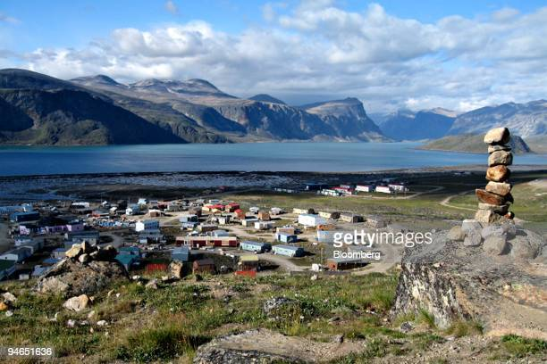 A native Inukshuk or stone cairn overlooks the community of Pangnirtung Nunavut Canada on Aug 19 2007 While comfortable Caribbean cruises still...
