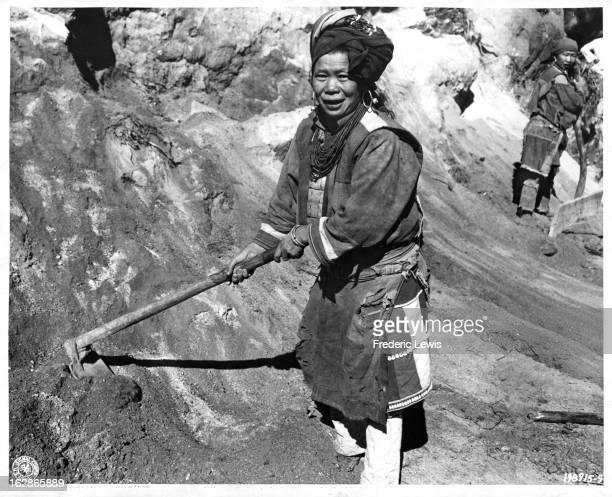 Native Lisu woman working on road in Myanmar 1955