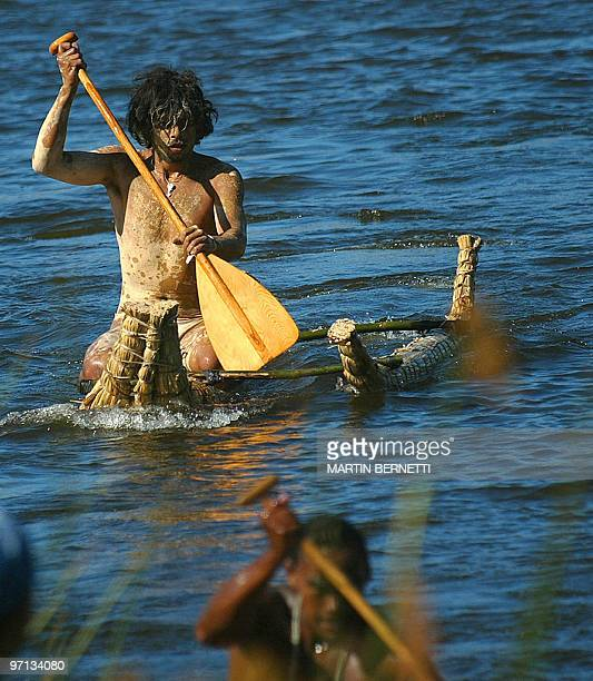 A native man paddles in a cattail balsa during the traditional Tapati festival of the Rapanu folklore in Easter Island Chile 04 February 2005 AFP...