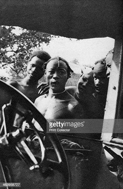 Native men seeing a white woman for the first time Mongalla to Terrakekka Sudan 1925 A print from Cape to Cairo by Stella Court Treatt George G...