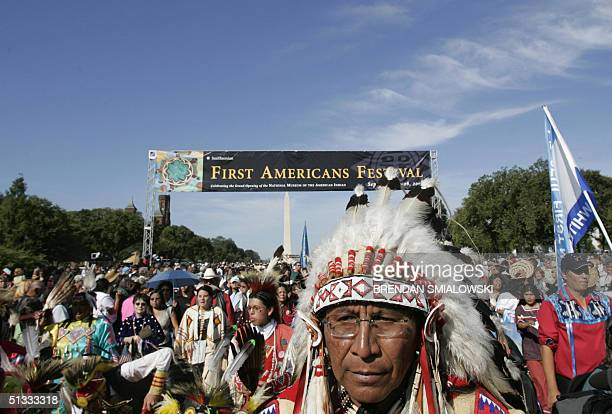 Native peoples from the Western Hemisphere and beyond walk down the National Mall during the grand opening of the Smithsonian's National Museum of...