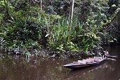 A native sails a canoe at the Sani River into the Yasuni Ecuadorean National Park in the Orellana ProvinceEcuador on June 15 2012 The Yasuni National...