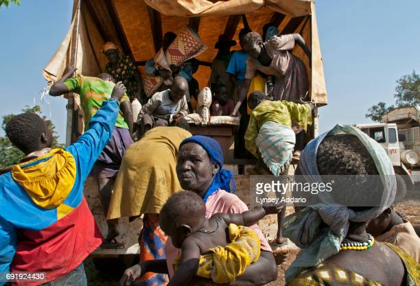 Native Southern Sudanese unload their belongings outside of Kajo Keji after returning to Southern Sudan for the first time in two decades from Uganda...
