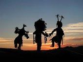 native american dancers at sunset