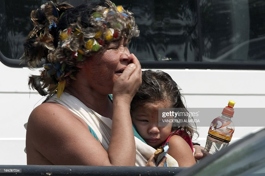 A native woman and her daughter cry during their eviction by riot police forces, outside the former Indigenous Museum --aka Aldea Maracana-- next to the Maracana stadium in Rio de Janeiro, Brazil on March 22, 2013. Indigenous people have been occupying the place since 2006, which is due to be pulled down to construct a parking lot for the upcoming Brazil 2014 FIFA World Cup.